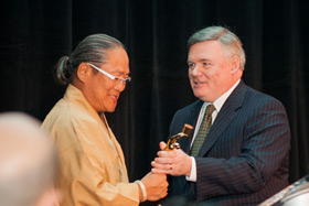 Chef Morimoto accepts his Augie from CIA President Tim Ryan
