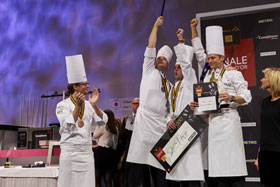Team USA celebrates on the medal stand at the 2015 Bocuse d'Or after finishing an unprecedented second place.