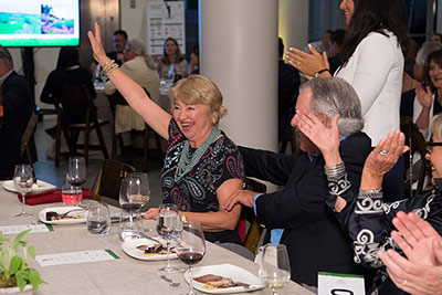 An excited winner of an auction lot on the first day of the CIA's Thomas Keller Golf Classic at The Culinary Institute of America at Copia in Napa, CA