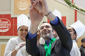 "Pastry chef Dominique Ansel takes a photo—an ""Anselfie,"" he calls it—with graduates of The Culinary Institute of America."