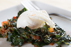 Bacon Sautéed Greens with a Poached Egg