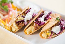 Breakfast Tacos with Cochinita Pibil, Scrambled Eggs and Habañero Crema