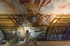 Restoration work continues on the ceiling of the throne room of Castello di Ugento, a 900-year-old castle in Puglia, Italy