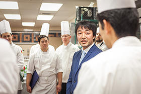 Ikuo Miyanaga, deputy consul general and director of the economic division at the Consulate of Japan in New York City, speaks with students at The Culinary Institute of America