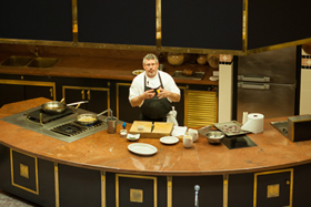 Jeremy Sewall '92 holds a cooking demonstration for students.