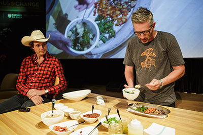 Merlin Verrier (at table), culinary director of Next Door, and Kimbal Musk, co-founder of The Kitchen offer a demonstration at the 5th annual Menus of Change Leadership Summit at the CIA