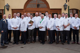 Michel Roux, Sr. (center, with cordon and medallion) and 15 of his protégés.