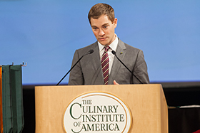 Restaurant industry technology entrepreneur Noah Glass speaks to associate degree graduates at the CIA's New York campus on December 21, 2016