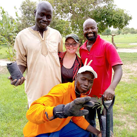 Caitlin-Magruder-and-threeGambian-men-during-a-tree-planting exercise.