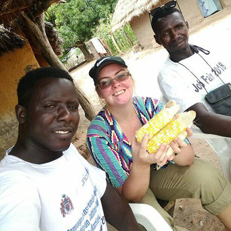 Caitlin Lamin (left) and Abdoulie (right) after a day of harvesting corn.
