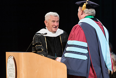 Robert Bennett stands with Dr. T. Ryan after delivering the keynote commencement address at The CIA.