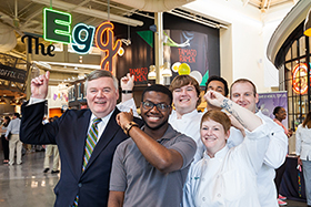 Dr. Tim Ryan, president of The Culinary Institute of America, with CIA students at the opening of the groundbreaking student dining venue, The Egg, in 2015