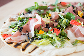 Grilled Pizza with Prosciutto di San Daniele, Burrata, Olive Dust and Herb Salad