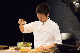 Zaiyu Hasegawa demonstrates one of his signature recipes, Foie Gras Monaka, at the 2015 Worlds of Flavor conference.
