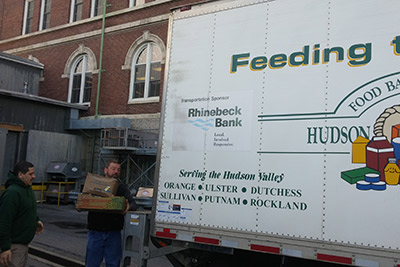 Angel Rivera of The Culinary Institute of America and Rich Johnson of the Food Bank of the Hudson Valley load food donations from the college onto a Food Bank truck on April 20, 2018.