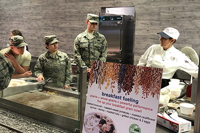 American service members at Spangdahlem Air Force Base in Germany learn about healthy eating from Chef Lisa Brefere of the CIA Consulting team