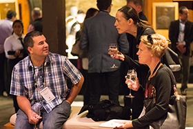 Attendees of reThink Food enjoy food, wine, and networking opportunities in the CIA's historic barrel room during conference breaks