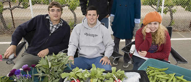 CIA Greystone students from the Student Garden Project and their mentor Chris Loss at the Saint Helena Farmers Market.