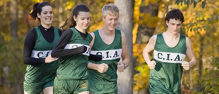 Read about the athletics coach for CIA's college cross country team