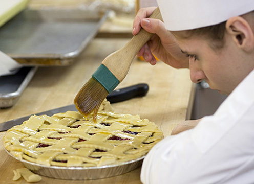 Baking & Pastry Student Preparing a Pie