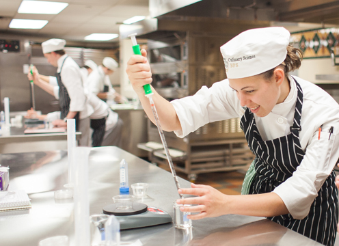 A bachelor's degree in Culinary Science from the CIA will teach you the scientific foundations of food production and prepare you for exciting research and development careers. Photo: Food science instructor demonstrates the use of dry ice in one of the CIA's many production kitchens.