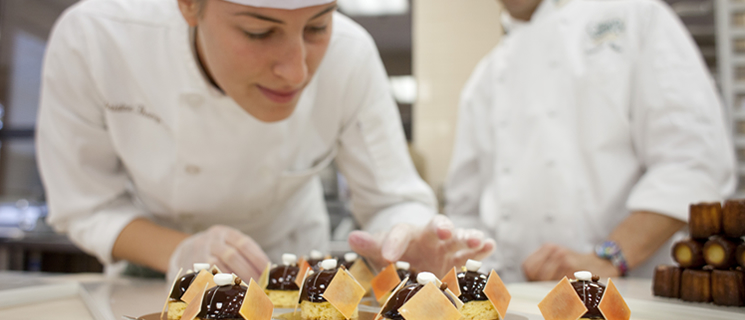 CIA student with prior work experience making dessert, through the Turbo Accelerated Culinary Degree program.