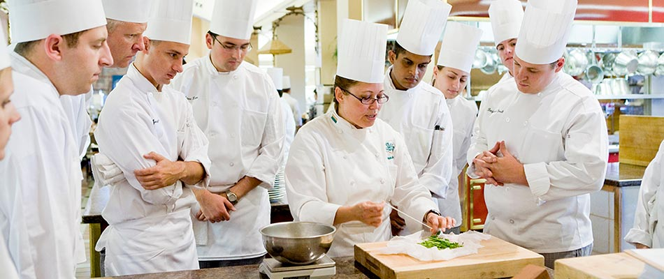 Culinary school students in the kitchen learning from CIA faculty who are leaders in their fields.
