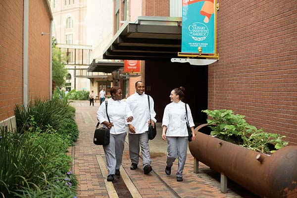 Students walking outside the CIA in San Antonio, TX - a culinary school campus where students enjoy a spirited city life.